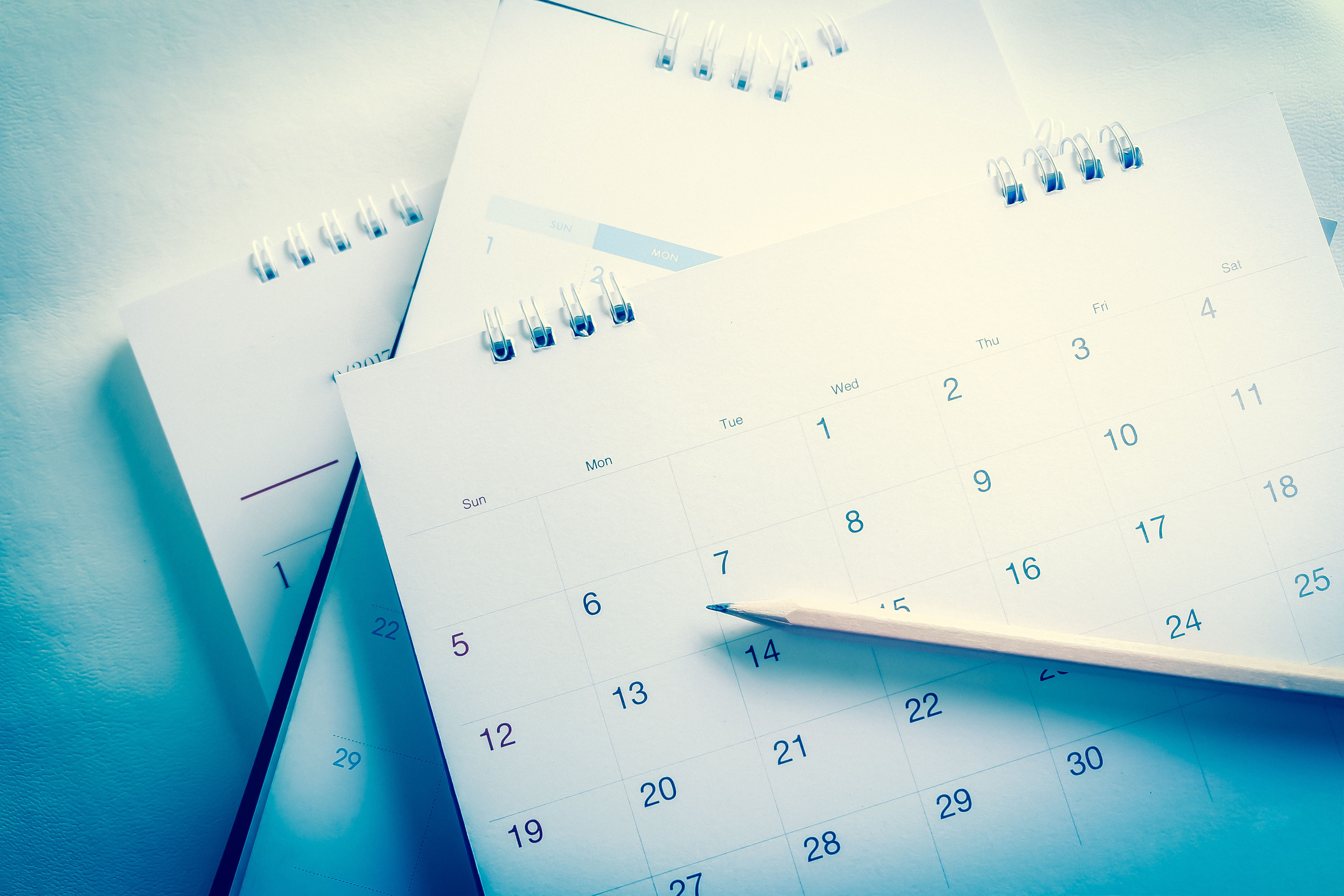 Calendars with pencil on top