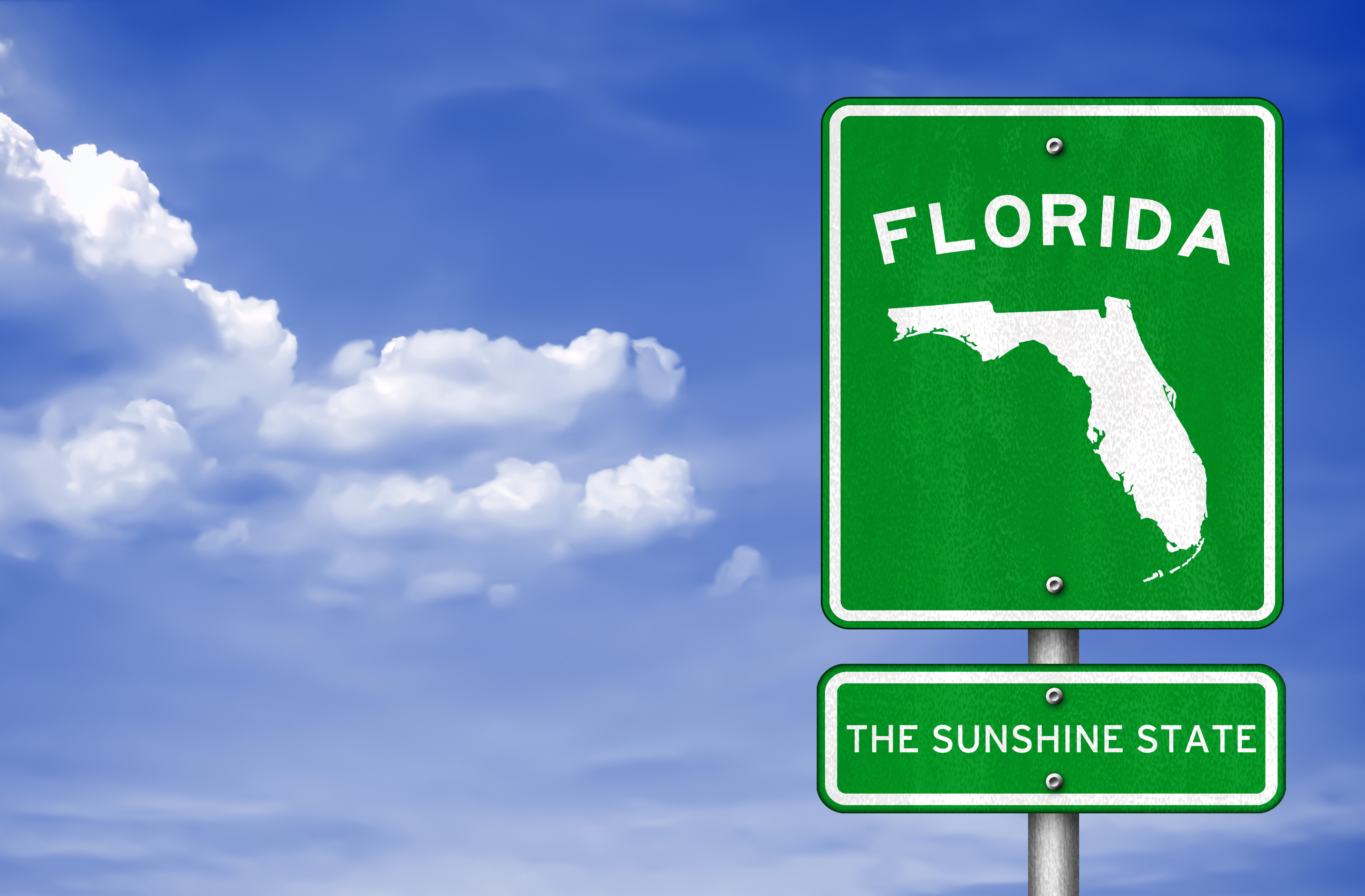Road sign for Florida with blue sky background